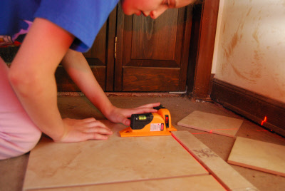 Using The Tile Laser Level To Set Tiles With Spacers