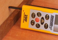 The Johnson Laser Distance Measure features an extension that flips out from the bottom of the unit to perform measurements in awkward positions.