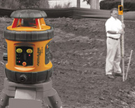 Rotary Laser level on tripod outdoors with laser detector checking grade